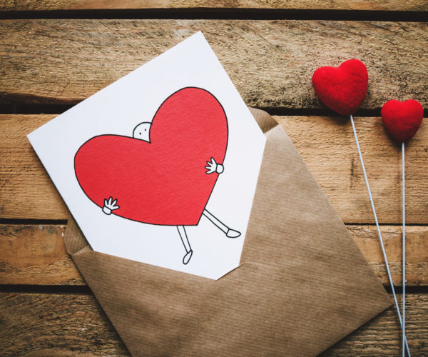 Canva - White, Black, and Red Person Carrying Heart Illustration in Brown Envelope